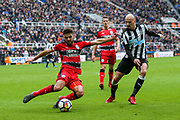 Tommy Smith (#2) of Huddersfield Town clears the ball under pressure from Jonjo Shelvey (#8) of Newcastle United during the Premier League match between Newcastle United and Huddersfield Town at St. James's Park, Newcastle, England on 31 March 2018. Picture by Craig Doyle.