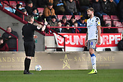 Colchester United player Harry Pell(8) is shown yellow card during the EFL Sky Bet League 2 match between Scunthorpe United and Colchester United at Glanford Park, Scunthorpe, England on 14 December 2019.