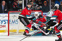 KELOWNA, BC - SEPTEMBER 28:  Roman Basran #30 defends the net as Kaedan Korczak #6 of the Kelowna Rockets tries to block the opening against the Everett Silvertips  at Prospera Place on September 28, 2019 in Kelowna, Canada. (Photo by Marissa Baecker/Shoot the Breeze)