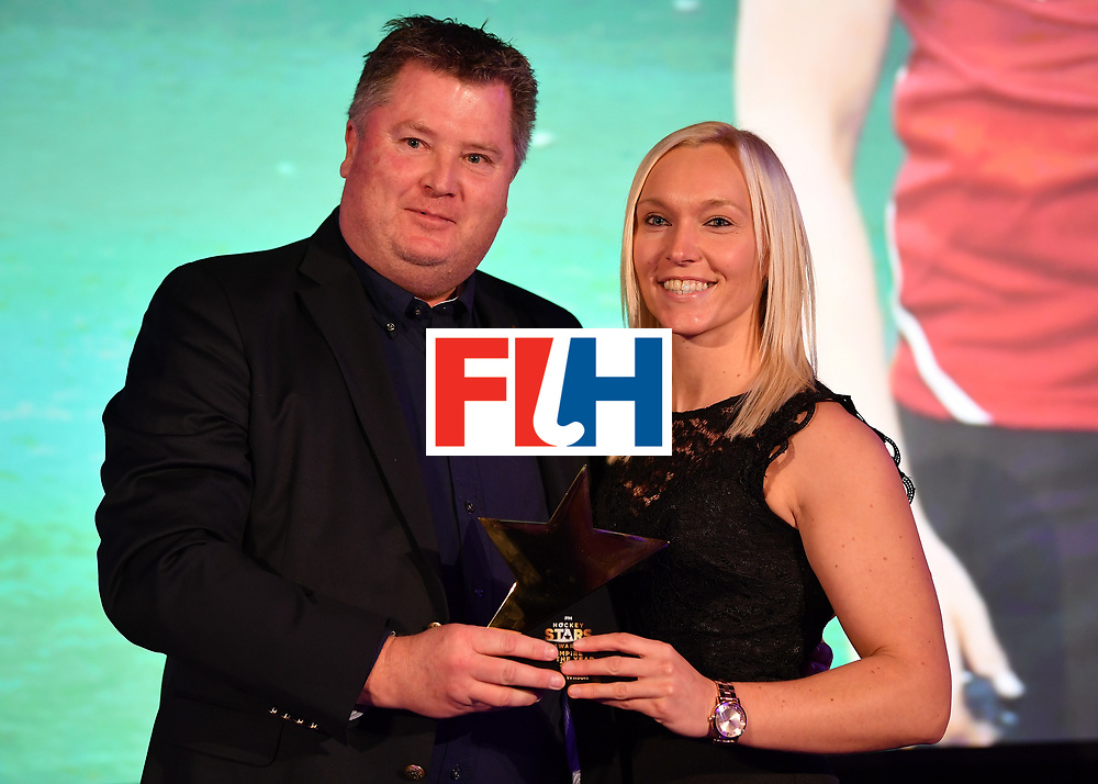 BERLIN, GERMANY - FEBRUARY 05:  Sarah Wilson  of Scotland with her female umpire of the year award during the Hockey Star Awards night at Stilwerk on February 5, 2018 in Berlin, Germany.  (Photo by Stuart Franklin/Getty Images For FIH)