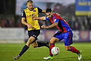 Aldershot Town defender Lewis Kinsella (20) (right) holds off Ebbsfleet United midfielder Luke Coulson (25) during the Vanarama National League match between Aldershot Town and Ebbsfleet United at the EBB Stadium, Aldershot, England on 20 January 2018. Photo by Alistair Wilson.