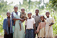 Rachel (12) and her extended family.<br /> Left to right: Irene, Rachel holding Eddy, Shakiray, Abbay, Ndagire and Maria.<br /> <br /> It was a privilege to capture the spirit of these brave young children who were orphaned by HIV AIDS.<br /> <br /> More of Rachel's story features in a previous image in this gallery.<br /> <br /> Rural Uganda, near Jinja