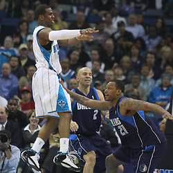 05 March 2009: New Orleans Hornets guard Chris Paul (3) passes the ball away as Dallas Mavericks guard Antoine Wright (21) closes in on defense during a NBA game between the New Orleans Hornets and the Dallas Mavericks at the New Orleans Arena in New Orleans, Louisiana.