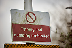 """FIL PICTURE: Thames Water has been fined a record £20m after pumping nearly 1.5 billion litres of untreated sewage into the River Thames.<br /> © Licensed to London News Pictures. 02/02/2017. AYLESBUY, UK.  Detail view of a tipping and dumping prohibited sign at the Aylesbury Sewage Treatment Works site, operated by Thames Water. The utility company is due to be sentenced at Aylesbury Crown Court after pleading guilty to a range of environmental offences dating back to 2013. This site recorded 3,500 high priory alarms over a nine month period and was described in court by the prosecuting barrister as """"completely out of control."""" In total nearly half a billion liters of raw or untreated sewage was discharged into the Thames from five sites in Buckinghamshire and Oxfordshire.    Photo credit: Cliff Hide/LNP"""