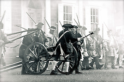 Slide 8 - Out of range of enemy muskets, revolutionary troops load a light cannon, stationed across the road from Cliveden.
