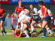 Canadian Sara Kaljuvee runs over a Spanish defender during the Emirates Dubai rugby sevens match between Canada and Spain  at the Sevens Stadium, Al Ain Road, United Arab Emirates on 1 December 2016. Photo by Ian  Muir.*** during the Emirates Dubai rugby sevens match between *** and ***  at the Sevens Stadium, Al Ain Road, United Arab Emirates on 1 December 2016. Photo by Ian  Muir.