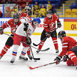 WHITBY, - Dec 16, 2015 -  Game #8 - Czech Republic vs. Canada East at the 2015 World Junior A Challenge at the Iroquois Park Recreation Complex, ON. Matyas Kantner #29 of Team Czech Republic attempts to shot the puck while surrounded by Team Canada East players during the first period.<br /> (Photo: Shawn Muir / OJHL Images)