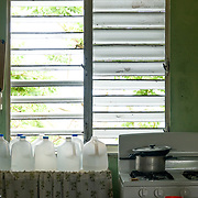 NOVEMBER 17, 2017&ndash;MARICAO, PUERTO RICO&mdash;<br /> Water in plastic gallon jugs inside Felicita Dragones's kitchen in her Hurricane Maria damaged house in the mountain town of Maricao. Dragons lives alone in the house which lost parts of its roof and is now covered with a blue tarp.<br /> (Photo by Angel Valentin)