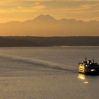 USA, Washington, Seattle, Aerial view of Washington State Ferry sailing through Elliot Bay at sunset on summer evening