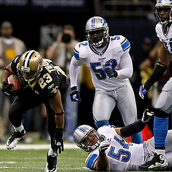 January 7, 2012; New Orleans, LA, USA; New Orleans Saints running back Pierre Thomas (23) escapes from Detroit Lions linebacker DeAndre Levy (54) during the 2011 NFC wild card playoff game at the Mercedes-Benz Superdome. Mandatory Credit: Derick E. Hingle-US PRESSWIRE