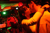 A couple kisses as a salsa band plays a show in the Zona Rosa, an area of nightclubs and restaurants in north Bogotá, on October 5, 2007. Salsa is one of the most popular forms of music in Colombia and throughout most of Latin America. (Photo/Scott Dalton)