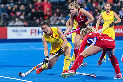 Zixia Ou of China Women clears the ball past Hannah Martin of Great Britain Women during the 2019 Women's FIH Pro League match at Lee Valley Hockey Centre, Stratford<br /> Picture by Simon Parker/Focus Images Ltd <br /> 03/05/2019