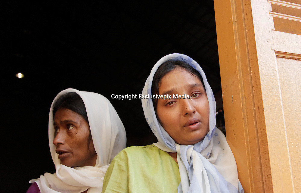 """ACEH, INDONESIA - MAY 12: <br /> <br /> Hundreds of Rohingya Muslim refugees rescued from boats off Indonesia<br /> <br /> Almost 900 men, women and children have been rescued from boats off the coast of Aceh, Indonesia in just two days, according to local officials.<br /> <br /> Fishermen spotted the first group of 547 people early on Sunday morning, according to Tegas, an officer at the North Aceh Immigration Office, where they're being processed.<br /> <br /> """"They (refugees) were drifting out at sea for a days, maybe even longer, without food and water. Many of them are weak and depressed. There a number of very young children too,"""" said Tegas, who only uses one name.<br /> <br /> The rescued migrants are staying in several shelters while they undergo immigration, health and security checks. The local government was providing food and water, but Tegas said shelters were becoming overcrowded and supplies were being stretched thin.<br /> <br /> """"We're doing the best we can but we have limited supplies too and this is creating tension among them,"""" he said.<br /> <br /> Found at sea<br /> The first group of migrants was found traveling in six boats off the Aceh coast, near the city of Lhokseumawe, said Budiawan, the head of the Aceh Search and Rescue Agency.<br /> <br /> He said another boat carrying around 400 people was spotted around 2 a.m. local time on Monday, further north along the coast. """"We sent teams there to help evacuate the people off the boat,"""" Budiawan said. He said it wasn't clear where they were heading.<br /> <br /> The International Organization for Migration has sent staff to Aceh to care for the migrants and learn where they came from and why.<br /> <br /> """"It is a mixed group Rohingya and Bangladeshi as far as we can tell now. We have staff with relevant language skills in the visiting IOM group, so will hopefully get better information in the coming hours,"""" said Steve Hamilton, IOM Deputy Chief of Mission in Indonesia.<br /> <br /> Rohingya ha"""