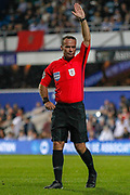 Referee Paul Tierney pointing, directing, signalling during the EFL Sky Bet Championship match between Queens Park Rangers and Swansea City at the Kiyan Prince Foundation Stadium, London, England on 21 August 2019.