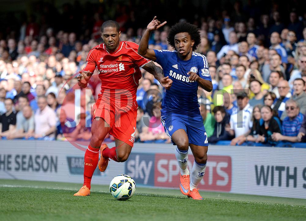 Liverpool's Glen Johnson battles for the ball with Chelsea's Willian  - Photo mandatory by-line: Alex James/JMP - Mobile: 07966 386802 - 10/05/2015 - SPORT - Football - London - Stamford Bridge - Chelsea v Liverpool - Barclays Premier League