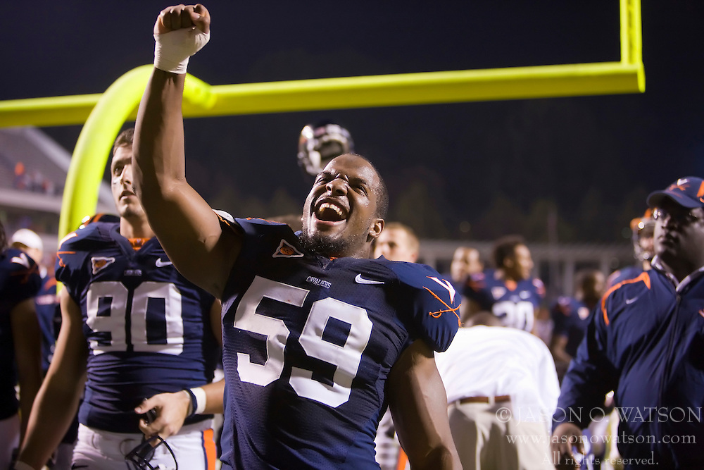 "Virginia linebacker John-Kevin Dolce (59) celebrates after UVA""s win.  The Virginia Cavaliers defeated the Maryland Terrapins 31-0 in NCAA football at Scott Stadium on the Grounds of the University of Virginia in Charlottesville, VA on October 4, 2008."