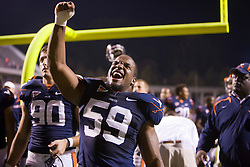 "Virginia linebacker John-Kevin Dolce (59) celebrates after UVA""s win.  The Virginia Cavaliers defeated the Maryland Terrapins 31-0 in NCAA football at Scott Stadium on the Grounds of the University of Virginia in Charlottesville, VA on October 4, 2008."