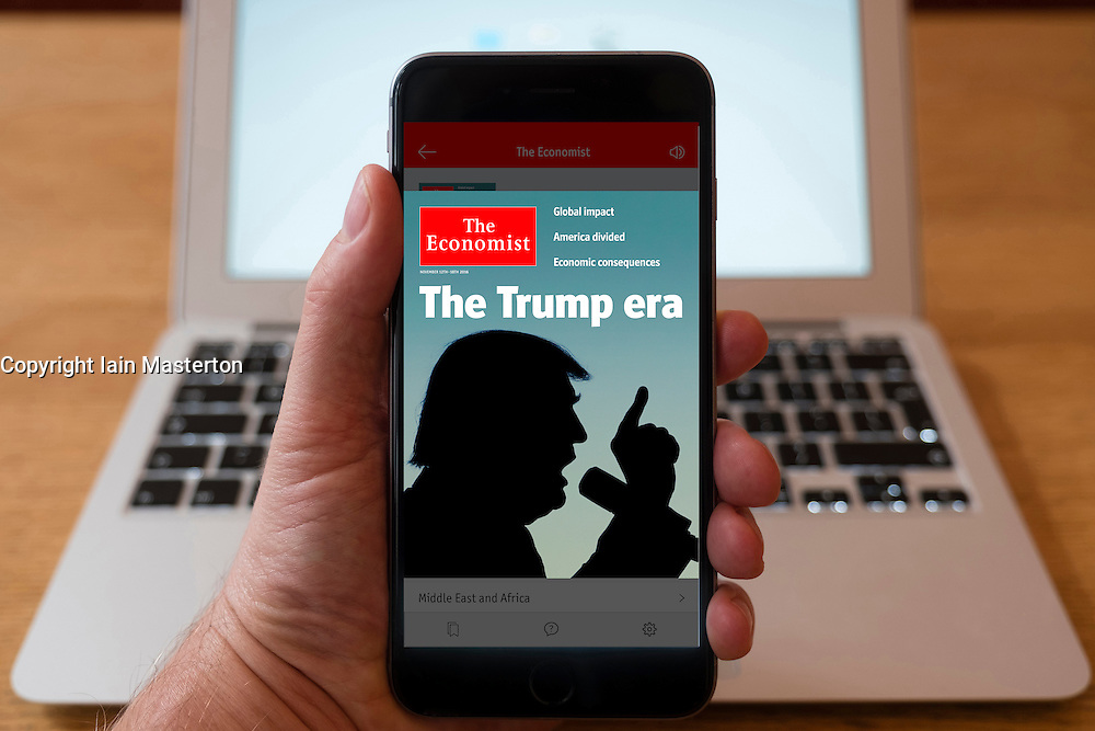 Detail of iPhone smart phone showing online mobile  newspaper front-page headline from The Economist  following Donald Trump's victory in 2016 US Presidential Election