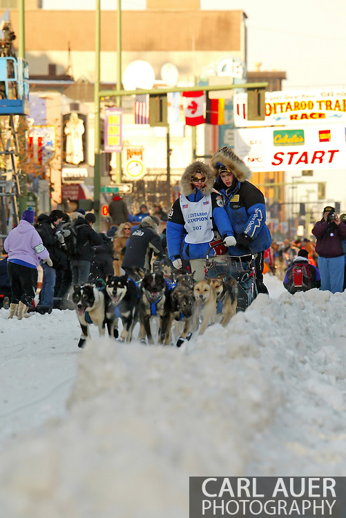 3/3/2007:  Anchorage Alaska -  Cain Carter of Kasilof, AK, winner of the 2007 Junior Iditarod, hits the trail first as the Pace Sled prior to the start of the 35th Iditarod Sled Dog Race