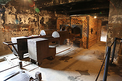 Interior of the crematorium of Auschwitz I, at the Auschwitz-Birkenau Nazi concentration camps in Auschwitz, Poland on September 3, 2017. Auschwitz concentration camp was a network of German Nazi concentration camps and extermination camps built and operated by the Third Reich in Polish areas annexed by Nazi Germany during WWII. It consisted of Auschwitz I (the original camp), Auschwitz II–Birkenau (a combination concentration/extermination camp), Auschwitz II–Monowitz (a labor camp to staff an IG Farben factory), and 45 satellite camps. In September 1941, Auschwitz II–Birkenau went on to become a major site of the Nazi Final Solution to the Jewish Question. From early 1942 until late 1944, transport trains delivered Jews to the camp's gas chambers from all over German-occupied Europe, where they were killed en masse with the pesticide Zyklon B. An estimated 1.3 million people were sent to the camp, of whom at least 1.1 million died. Around 90 percent of those killed were Jewish; approximately 1 in 6 Jews killed in the Holocaust died at the camp. Others deported to Auschwitz included 150,000 Poles, 23,000 Romani and Sinti, 15,000 Soviet prisoners of war, 400 Jehovah's Witnesses, and tens of thousands of others of diverse nationalities, including an unknown number of homosexuals. Many of those not killed in the gas chambers died of starvation, forced labor, infectious diseases, individual executions, and medical experiments. In 1947, Poland founded a museum on the site of Auschwitz I and II, and in 1979, it was named a UNESCO World Heritage Site. Photo by Somer/ABACAPRESS.COM