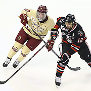 Zach Aston-Reese #12 of the Northeastern Huskies and Michael Sit #18 of the Boston College Eagles jostle for position during The Beanpot Championship Game at TD Garden on February 10, 2014 in Boston, Massachusetts. (Photo by Elan Kawesch)