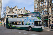 Electric hybrid green number bus drives along a street in Oxford City, England, United Kingdom.  Stagecoach hybrid buses are more environmentally greener than traditional buses using 30% fuel and third less CO2 emissions, the buses are also much quieter.  (photo by Andrew Aitchison / In pictures via Getty Images)