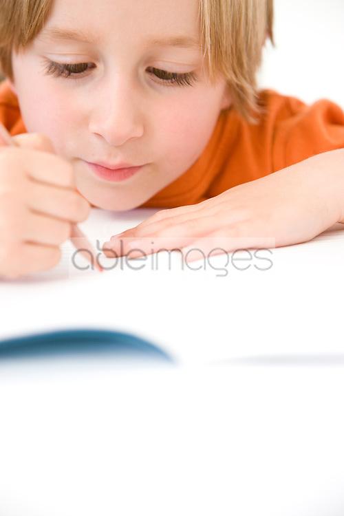 Young Boy Writing