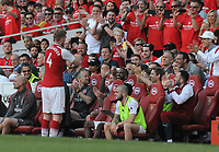 Football - 2017 / 2018 Premier League - Arsenal vs. Burnley<br /> <br /> Per Mertesacker of Arsenal puts his shirt on for the last time with applause from his team mates as he comes on as a substitute at The Emirates.<br /> <br /> COLORSPORT/ANDREW COWIE