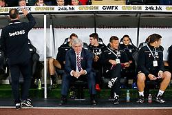 Stoke City Manager Mark Hughes looks on from the dugout - Mandatory byline: Rogan Thomson/JMP - 07966 386802 - 19/10/2015 - FOOTBALL - Liberty Stadium - Swansea, Wales - Swansea City v Stoke City - Barclays Premier League.