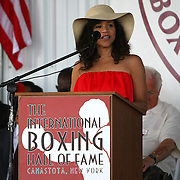 Actress Rosie Perez is seen on stage during the 2013 International Boxing Hall of Fame induction ceremony on Sunday, June 9, 2013 in Canastota, New York.  (AP Photo/Alex Menendez)