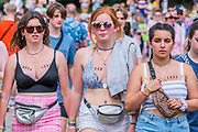 Henham Park, Suffolk, 21 July 2019. Boob Love is a serious business - People head in to the arean for the first time in the day.The 2019 Latitude Festival.