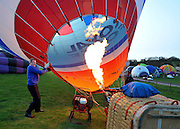 London News pictures. 07/04/2011. CANTERBURY: The Royal Airforce balloon is prepared for flight. Approximately 50 hot air balloons from across the UK and Europe take advantage of the weather window and take off from Lydden Hill Race Circuit, Wootton, Kent, to fly across the English Channel marking the largest ever group of balloons to attempt the crossing. The participants  have been waiting since October for the event to happen. Picture credit should read Stephen Simpson/LNP