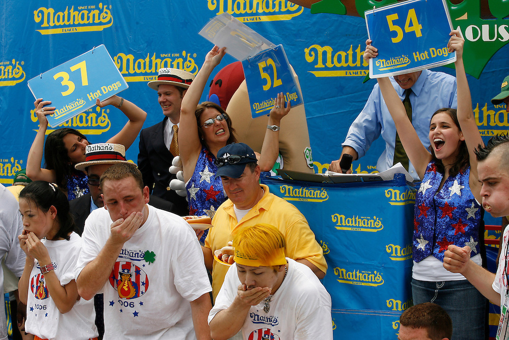 NEW YORK, NY-06 JUL04-- Takeru Kobayashi narrowly beats American favourite Joey Chestnut in the final seconds of the hot dog eating competition (Extra) The Gazette/Liam Maloney