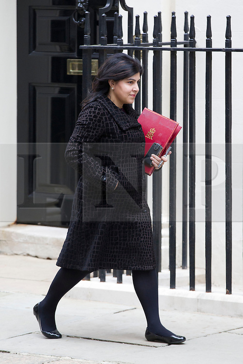 © Licensed to London News Pictures. 18/03/2014. London, UK. The Senior Minister of State at the Foreign & Commonwealth Office, Baroness Warsi, arrives for a meeting of the British cabinet on Downing Street in London today (18/03/2014). Photo credit: Matt Cetti-Roberts/LNP