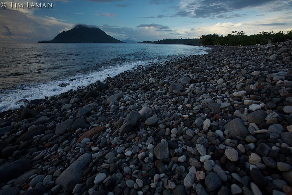 Hiri Island viewed from a volcanic rock beach on Ternate Island, North Moluccas, Indonesia.