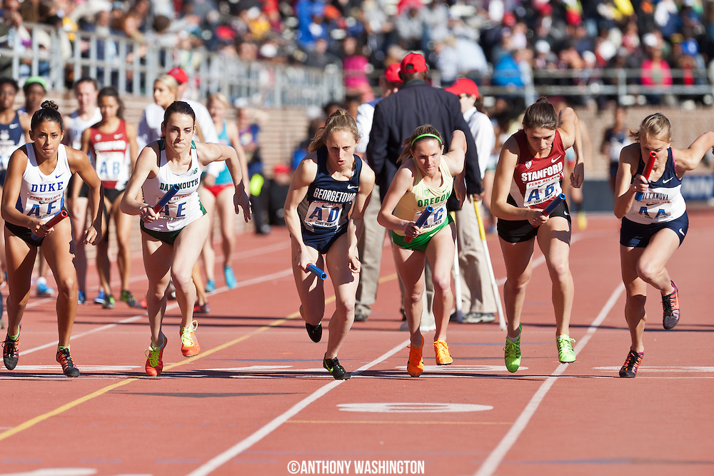 Andrea Keklak (center) of Georgetown University at the start of the College Women's Distance Medley Championship of America at the Penn Relays on Thursday, April 24, 2014 in Philadelphia, PA.