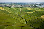 Nederland, Noord-Holland, Gemeente Ouder-Amstel, 25-05-2010. Amstelland, Polder de Rondehoep (ook Polder de Ronde Hoep), een van de grootste onbebouwde weidegebieden van de Randstad met karakteristiek stervormig kavelpatroon. Dit slotenpatroon van gerende verkaveling is ontstaan ten tijde van de ontginning in de middeleeuwen. Aan de horizon Ouderkerk, Amsterdam Zuid-as en Zuid-Oost..The Polder Rondehoep (or Polder Round Hoep), one of the largest undeveloped pasture area's in the Randstad with characteristic star-shaped pattern. This pattern is the result of the extraction during the Middle Ages..luchtfoto (toeslag), aerial photo (additional fee required).foto/photo Siebe Swart