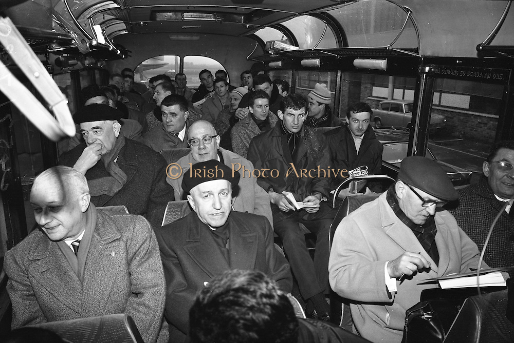 French Rugby team officials arriving at Dublin Airport for International match,..Irish Rugby Football Union, Ireland v France, Five Nations, Dublin, Ireland, Thursday 21st January, 1965,.21.1.1965, 1.21.1965,..Referee- D G Walters, Welsh Rugby Union, ..Score- Ireland 3 - 3 France, ..French Team, ..P Dedieu, Wearing number 15 French jersey, Full Back, A S Biterroise Rugby Football Club, France,. .J Gachassin, Wearing number 11 French jersey, Left Wing, F.C Lourdais Rugby Football Club, France, ..G Boniface, Wearing number 12 French jersey, Left Centre, Stade Montois Rugby Football Club, France,..J Pique, Wearing number 13 French jersey, Right Centre, S Paloise Rugby Football Club, France,..C Darrouy, Wearing number 14 French jersey, Right Wing, Stade Montois Rugby Football Club, France,..J Capdouze, Wearing number 10 French jersey, Stand Off, S Paloise Rugby Football Club, France,..L Camberabero, Wearing number 9 French jersey, Scrum Half, La Voulte Sportif Rugby Football Club, France,..J Berejnoi, Wearing number 1 French jersey, Forward, S C Tulliste Rugby Football Club, France,..J Cabanier, Wearing number 2 French jersey, Forward, U S Montalbanaise Rugby Football Club, France,..A Gruarin, Wearing number 3 French jersey, Forward, R.C Toulonnais Rugby Football Club, France,..W Spanghero, Wearing number 4 French jersey, Forward, R.C Narbonnais Rugby Football Club, France,..D Dauga, Wearing number 5 French jersey, Forward, Stade Montois Rugby Football Club, France,..M Lira, Wearing number 6 French jersey, Forward, La Voulte Sportif Rugby Football Club, France,..A Herrero, Wearing number 8 French jersey, Forward, R.C Toulonnais Rugby Football Club, France,..M Crauste, Wearing number 7 French jersey, Captain of the French team, Forward, F.C Lourdais Rugby Football Club, France, .  Irish Rugby Football Union, Ireland v France, Five Nations, French team practice at College Park, Dublin, Ireland, Friday 22rd January, 1965,.22.1.1965, 1.22.1965,..Referee- D G Walters, Welsh