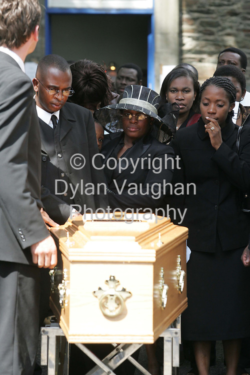 30/7/2004.The coffin of  Paiche Onyemaechi pictured at St Patricks Church in Waterford yesterday with family and friends.Picture Dylan Vaughan