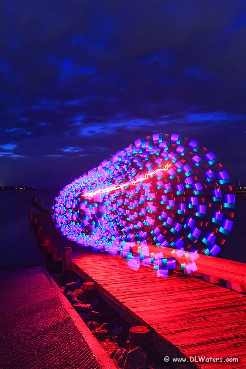 This photo was taken from a tripod with a long exposure. I used a flashing light stick and tied a string to the end. Then I spun it around and walked backwards down the dock while the exposure was being made.