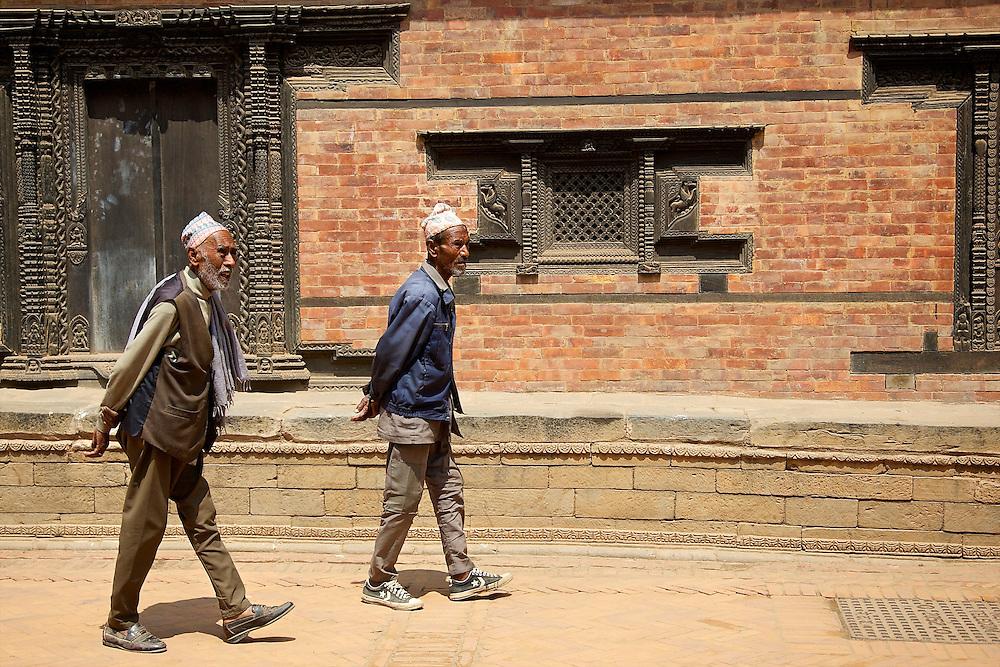 Men at Bhaktapur Durbar Square, Nepal.