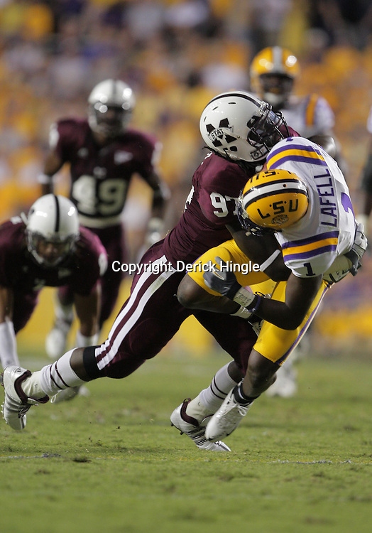 27 September 2008:  Mississippi State defensive lineman Jimmie Holmes (97) tackles LSU wide receiver Brandon LaFell (1) during the Mississippi State Bulldogs versus the LSU Tigers game at Tiger Stadium in Baton Rouge, LA.