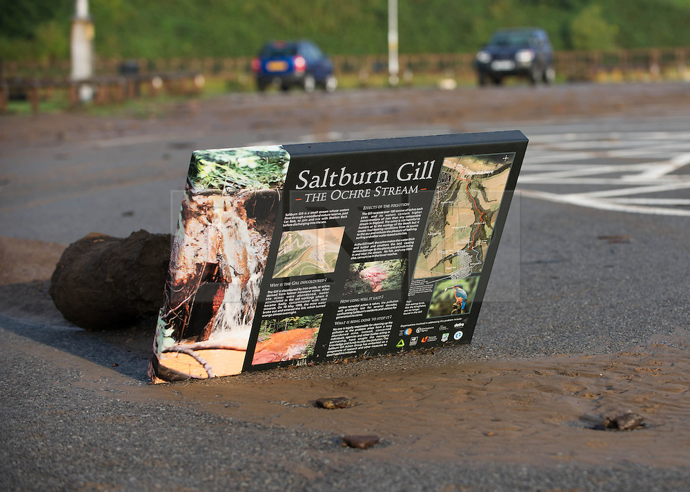 © Licensed to London News Pictures. 07/09/2013<br /> <br /> Saltburn, Cleveland, England<br /> <br /> A sign washed away by the rain gets in a car park following an evening of torrential rainfall that caused flooding and disruption to Saltburn in Cleveland.<br /> <br /> Photo credit : Ian Forsyth/LNP