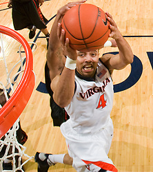 Virginia guard Calvin Baker (4) finishes a layup against Miami.  The Virginia Cavaliers fell to the Miami Hurricanes 62-55 at the John Paul Jones Arena on the Grounds of the University of Virginia in Charlottesville, VA on February 26, 2009.