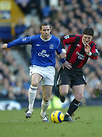 Fotball<br /> Premier League England 2004/2005<br /> Foto: SBI/Digitalsport<br /> NORWAY ONLY<br /> <br /> Everton v Manchester City<br /> Barclays Premiership<br /> 26/12/2004<br /> <br /> David Weir of Everton is challenged by Jon Macken of Manchester City.