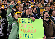 """A Green Bay Packers holds a sign stating """"ESPN Enjoy Super Packer Night"""" during the NFL week 10 football game against the Minnesota Vikings on Monday, November 14, 2011 in Green Bay, Wisconsin. The Packers won the game 45-7. ©Paul Anthony Spinelli"""