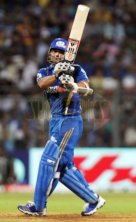 Mumbai Indian captain Sachin Tendulkar bats during match 59 of the the Indian Premier League ( IPL ) Season 4 between the Mumbai Indians and the Deccan Chargers held at the Wankhede Stadium, Mumbai, India on the 14th May 2011..Photo by BCCI/SPORTZPICS.