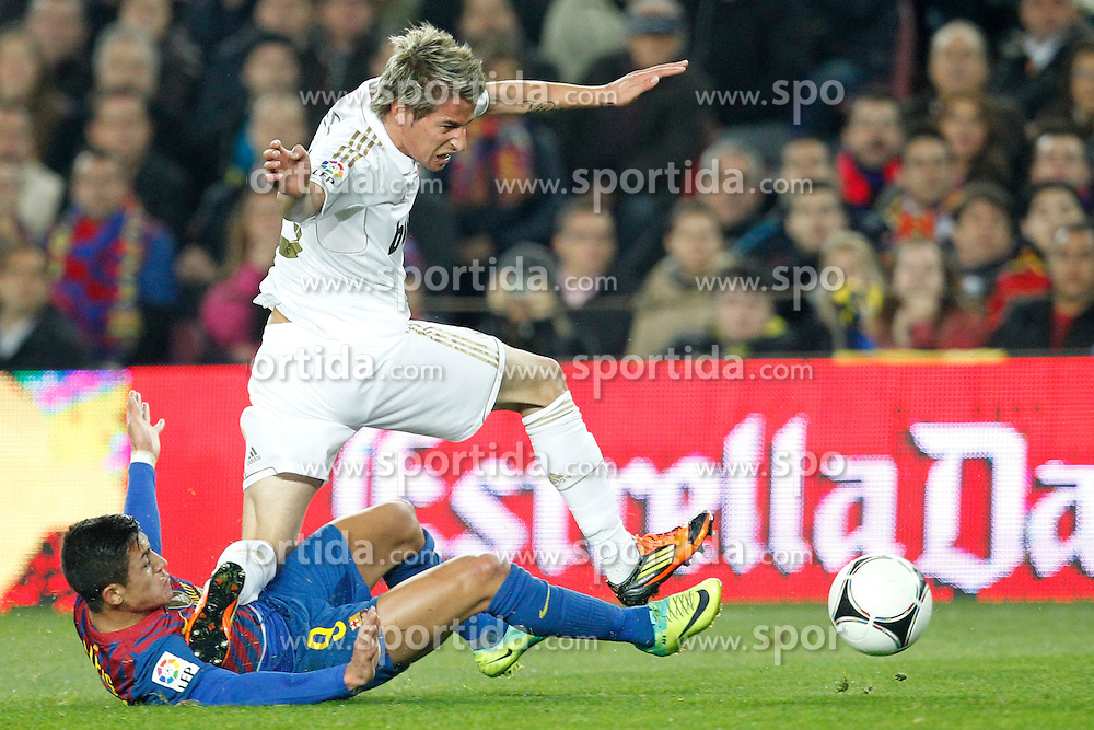 25.01.2012, Stadion Camp Nou, Barcelona, ESP, Copa del Rey, FC Barcelona vs Real Madrid, im Bild Barcelona's Alexis Sanchez and Real Madrid's Fabio Coentrao // during the football match of spanish Copy del Rey, between FC Barcelona and Real Madrid at Camp Nou stadium, Barcelona, Spain on 2012/01/25. EXPA Pictures © 2012, PhotoCredit: EXPA/ Alterphotos/ Cesar Cebolla..***** ATTENTION - OUT OF ESP and SUI *****