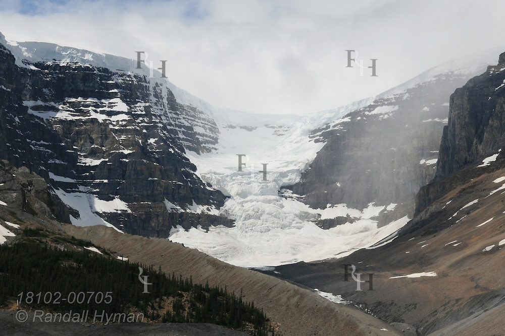 Massive lateral moraine is the rocky debris remnant of the repidly retreating Athabasca Glacier and Columbia Icefield in Jasper National Park, Alberta, Canada.