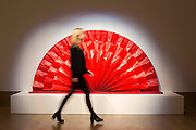 "UNITED KINGDOM, London: 1 February 2016 A Bonham's staff member takes a close look at Kazoo Shiraga's ""Untitled (Red Fan)"" (estimated to be worth £1,500,000 - 2,000,000) which forms part of the Post-War Contemporary Art Sale which opens 11th of February 2016. Other work includes Andy Warhol's ""Fourteen Small Electric Chairs"" estimated to be worth £4,000,000 - 6,000,000. Rick Findler  / Story Picture Agency"